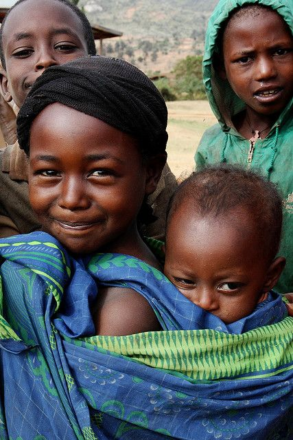 Lovely girl carrying baby sister or brother by ngari.norway on Flickr. Ethiopia