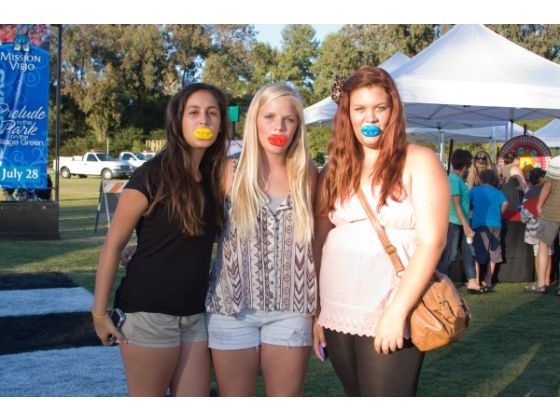 Sophia Accetta, Shanie Scoles and Mikayla Devries sport colorful wax lips during the Parisian-themed Target Symphony, Saturday in Mission Viejo.  JOSEPH ESPIRITU, FOR THE ORANGE COUNTY REGISTER