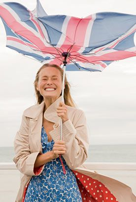 Don't forget your umbrellas during this typical British weather.:   I know this is a photographic work however i noticed how the insider of her coat is red and her dress is blue! which relates to 'British' and 'union jack' e.g. like the upside down umbrella. Love the idea with the brolly as it is just typical British weather!!