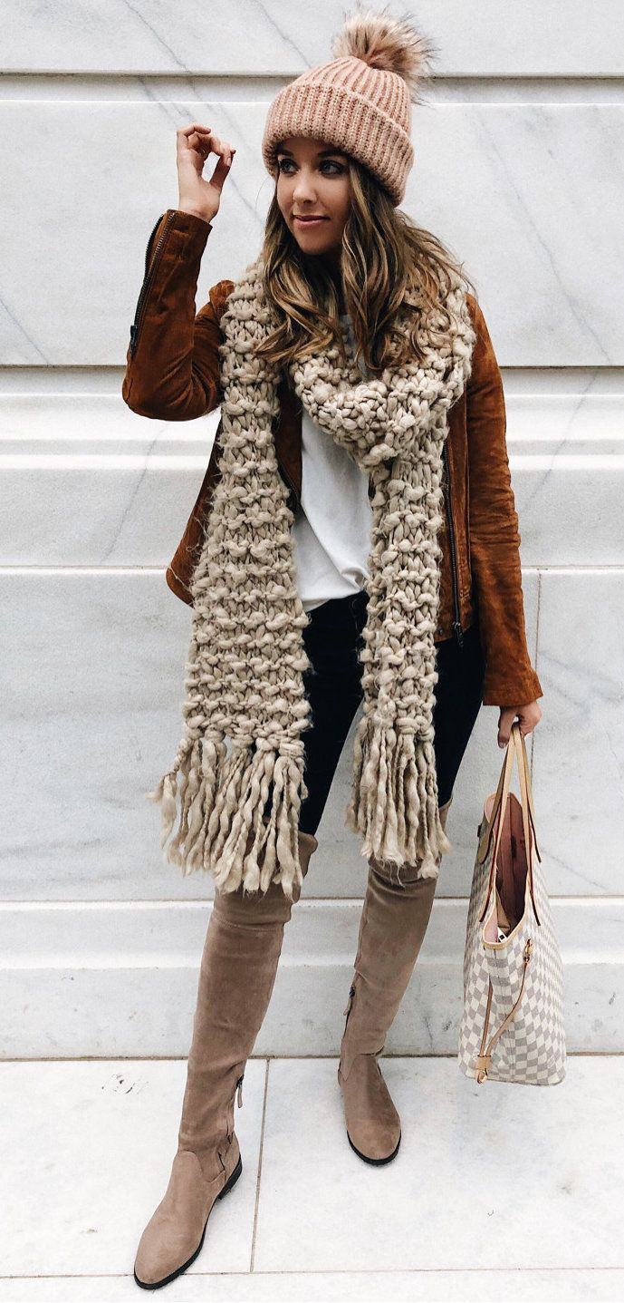 #winter #outfits pink bobble hat with beige scarf and brown cardigan. Click To Shop This Look.