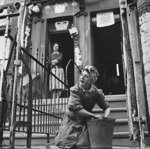 Cleaning her front steps for the Queens Coronation