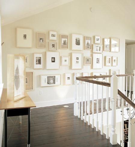 Frame arrangement- black and whites in neutral frames.