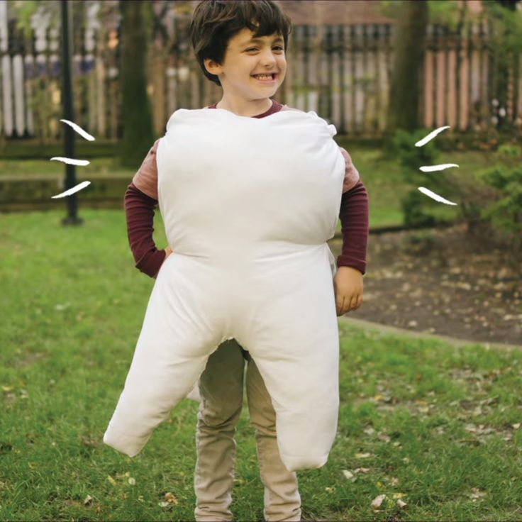 LOOKING FOR some costume inspiration? Here's a fun DIY tutorial on how to make your very own tooth costume!