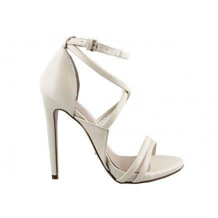 A bone pearl leather high heel featuring cross over straps.   Leather upper and…