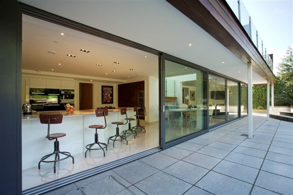 Large aluminium sliding doors open up the entire back of this property. Product used: Sunparadise Bali60 lift-and-slide doors.
