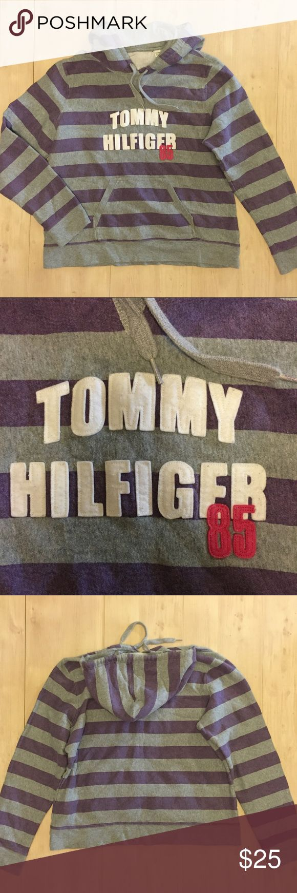 Tommy Hilfiger 86 spell out women's hoodie stripe Tommy Hilfiger 86 spell out patch purple gray stripe hoodie soft Sz XL pre owned no holes no stains no rips missing tag still can see where it was and the 1 800 tommy cares on material washing tag for authenticity thx for looking Tommy Hilfiger Tops Sweatshirts & Hoodies