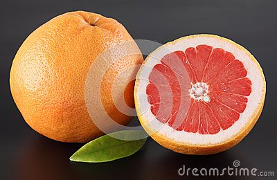 Grapefruits on black background. Closeup.