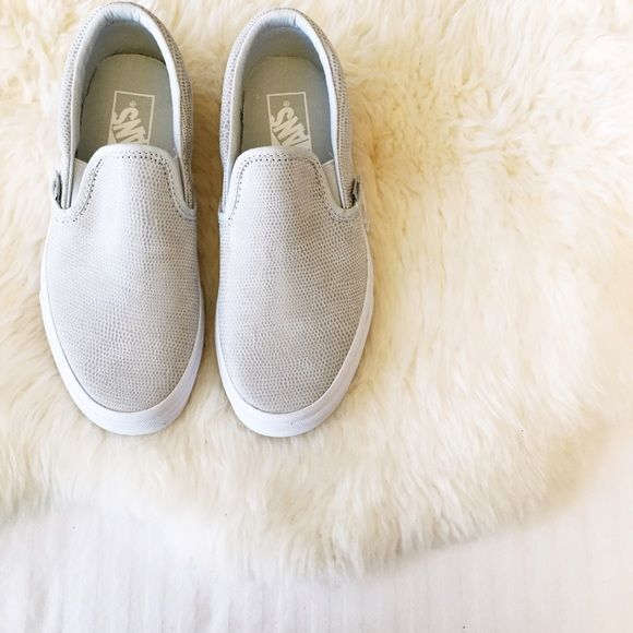 Vans Glacier Grey Leather Slip Ons •Vans textured leather slip ons. •Women's size 6.5. •New in box (no lid). •NO TRADES/PAYPAL/MERC/VINTED/NONSENSE. •PLEASE USE OFFER FEATURE IF YOU WANT TO NEGOTIATE PRICE. Vans Shoes Sneakers