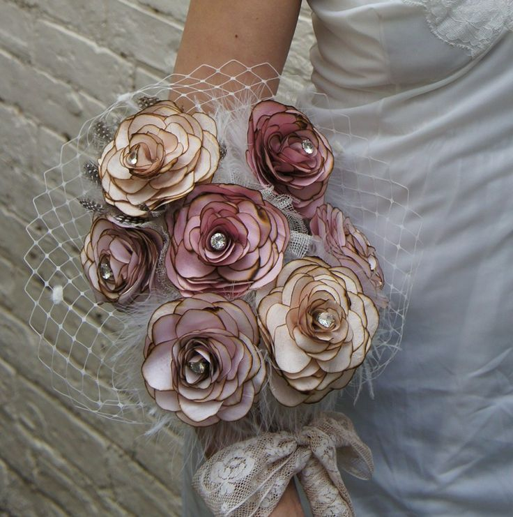 Recycled silk wedding bouquet in pale pinks with fluffy and ostrich feathers in ivory, antique lace, ivory veiling and rhinestones centers.