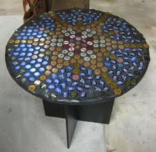 Beer Bottle cap table. Like making something out of wine corks...but slightly less classy.
