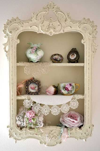 Love it!  Use a pretty frame to finish off a built in shelf unit.  Great idea for a medicine cabinet, or spice rack