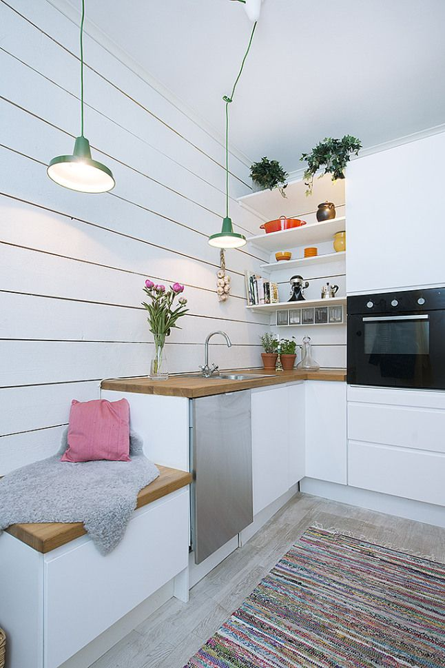 Small areas of the day: a kitchen with an island in a two rooms apartement