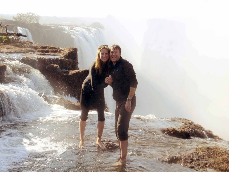 Standing on the edge of the romantic Victoria Falls while on honeymoon