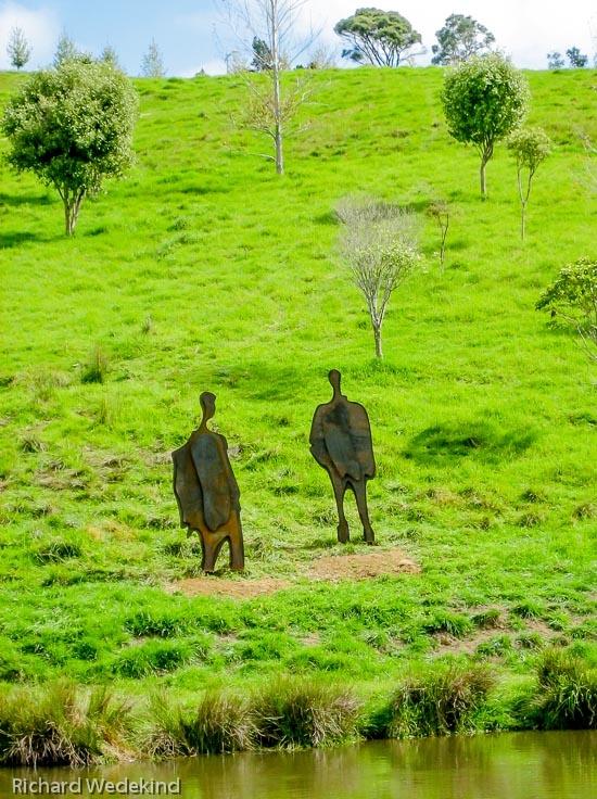 Conversation Piece: Corten steel figures (2.5m high) at Brick Bay Sculpture Trail, Warkworth.