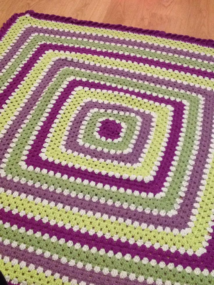 A blanket made for my friend Katie's birthday in colours to match her caravan! Plum, parchment, meadow, grape and pistachio in Stylecraft special DK