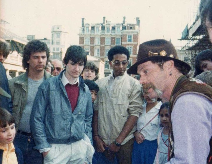 """Me, Albert Graham and Michael Vincent watching Jim Cellini's Chop Cup routine in Covent Garden (1982). Photographed by the great escapologist and magician """"Alan Alan""""."""