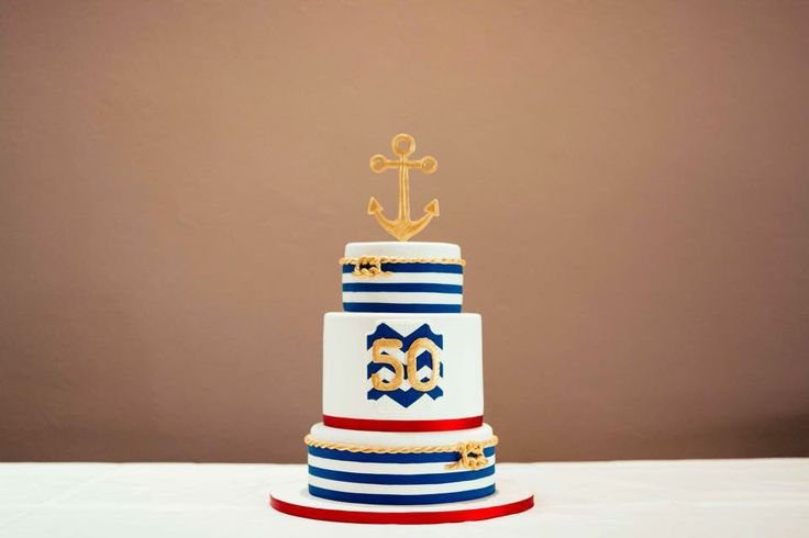 Nautical themed cake for a 50 celebration complete with edible anchor and reef knots