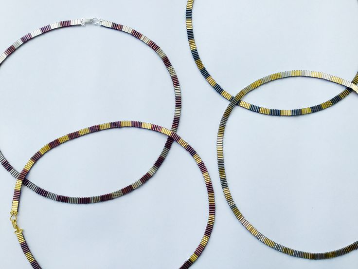 Curved necklaces made from silver and copper by Joanna Campbell