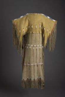American Indian Art:Beadwork and Quillwork, A SOUTHERN CHEYENNE GIRL'S BEADED AND FRINGED HIDE DRESS. c.1890...