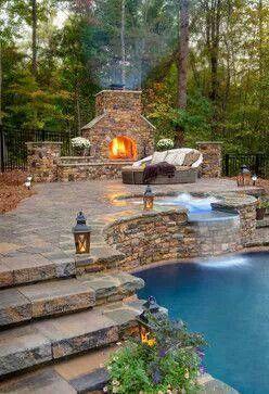 Beautiful backyard pool and fireplace.