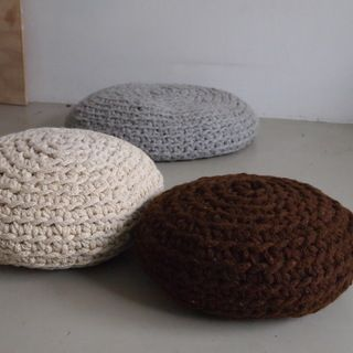 make a mega-crochet pouf//make a mega-crochet pouf - this instructable is FANTASTIC. not only does the author give you the pattern for free, she also teaches you how to make your own giant yarn out of smaller yarn so you don't have to spend an arm and a leg on giant wool