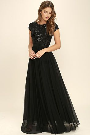 Better than a bouquet of roses, the L'amour Black Sequin Maxi Dress has us falling head over heels! Swirling black sequins cover a black mesh bodice with a bateau neckline, cap sleeves, and elasticized waistband. More mesh and a layer of organza create a full, maxi skirt. Hidden back zipper/clasp.