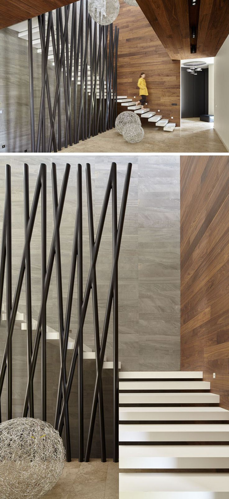 The large black metal poles protecting the side of this floating staircase have both a natural and industrial look to them that helps create a modern look throughout the home.