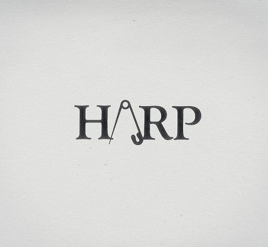 I'm having a little trouble resolving in my mind the relation between the text, 'HARP', and the image of a safety pin. And although I do still like the use of the pin as an 'A' in the design, overall I do not find the logo very memorable.