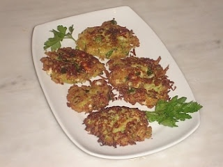 Zucchini Fritters - These tasty fritters are very easy to prepare and can be served as one of several side dishes - they go nicely with Tzatziki - or as a light snack on their own.