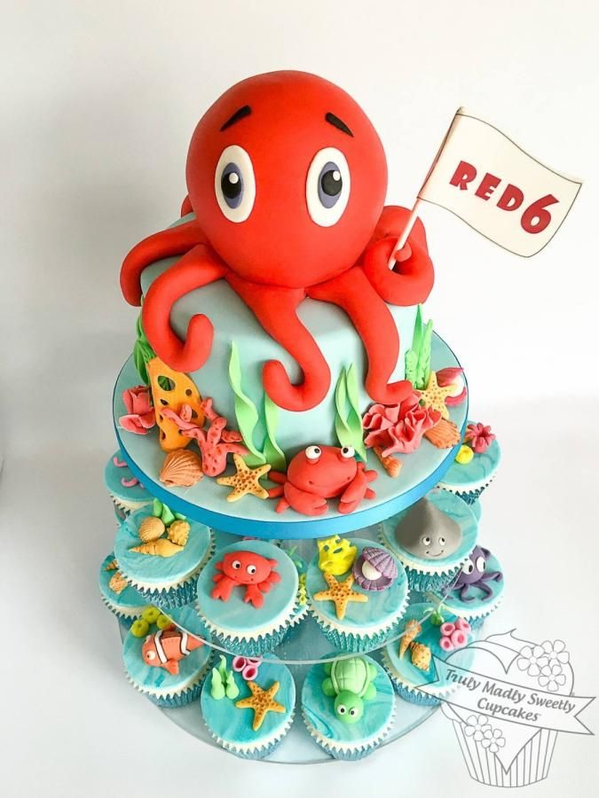 Under The Sea Octopus Cake and Cupcakes by Truly Madly Sweetly Cupcakes …See the cake: http://cakesdecor.com/cakes/233511-under-the-sea-octopus-cake-and-cupcakes