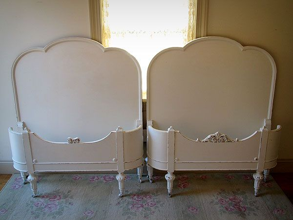 Charming White Antique Matching Curved Footboard Twin Beds