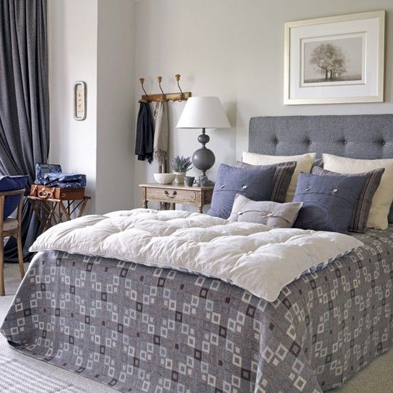 love the blue cushions setting, a lighter tone bedspread on top lightens the overall Look