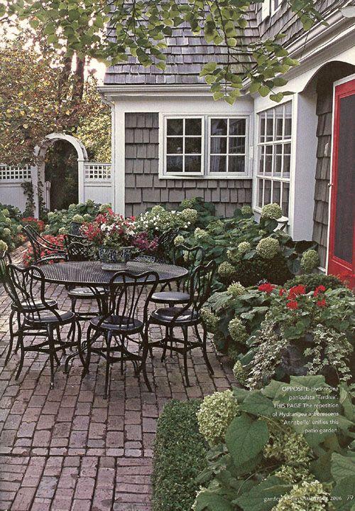 hydrangeas, old brick patio,fence & arbor
