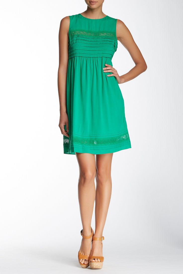 Polished and flattering, this green gem is office-ready!