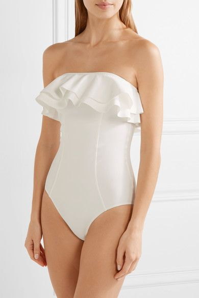 White bonded stretch-nylon Pulls on 72% nylon, 28% elastane Hand wash Lotion, sunscreen, oil and chlorine can cause discoloration of this item; this is not a manufacturing defect. Please follow care instructions to keep your swimwear in the best condition