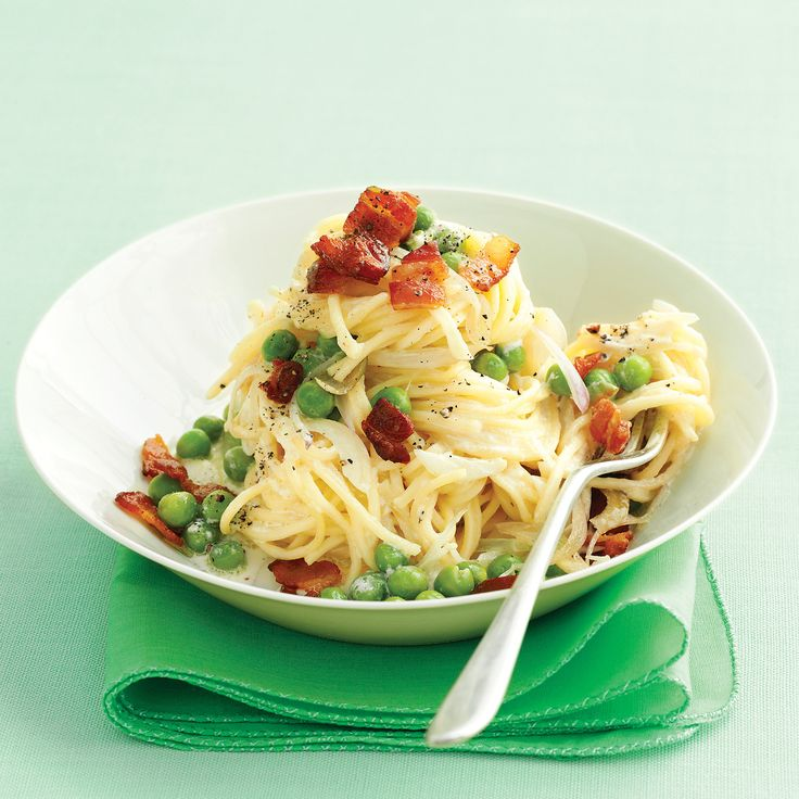 Inspired by pasta alla carbonara, this dish features bacon instead of pancetta, while shallots and peas give the sauce texture.