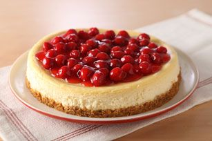 Baked cheesecake with cherries and a graham cracker crust