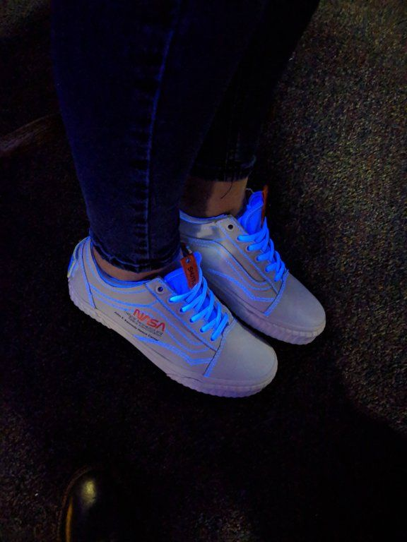 The white Nasa shoes look awesome in black light : Vans