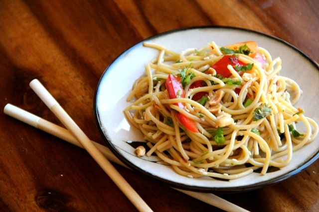 Cold Asian Noodle Salad with honey-soy dressing - 1/4 cup canola oil, 1T sesame oil, 1/2t red pepper flakes, 3T honey, 2T soy sauce
