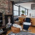 A London loft is filled with eclectic furniture finds, layered in fresh and unique ways. The result is a bright and bold home full of humor and style.