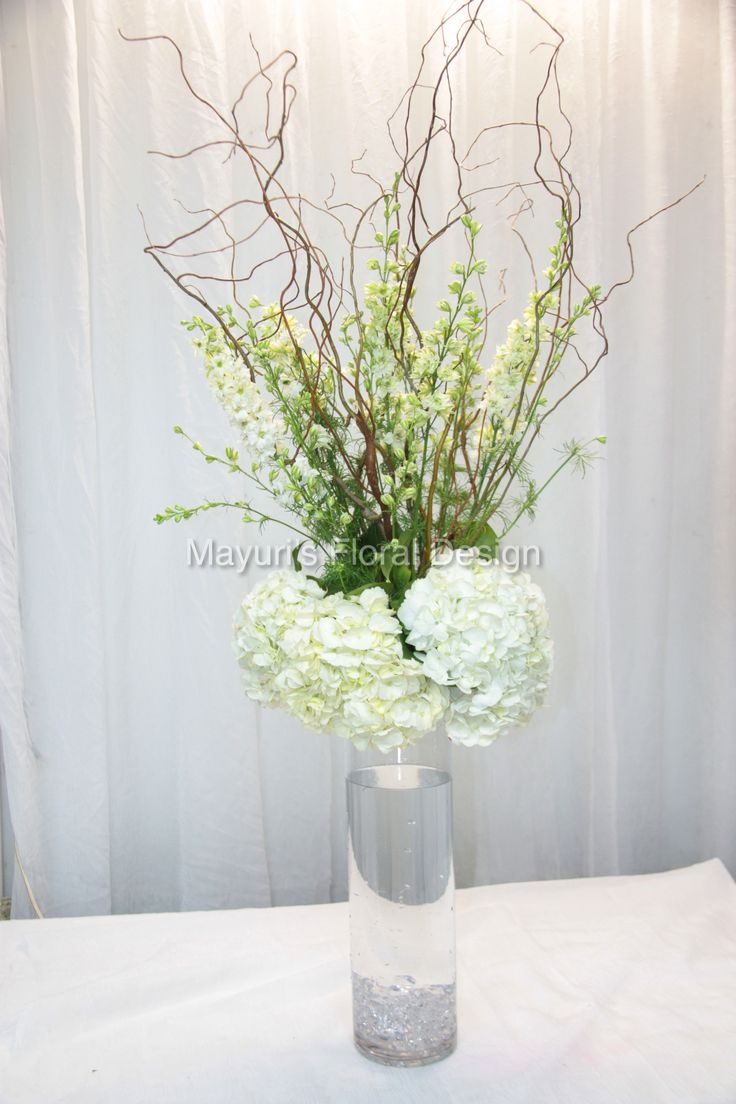 Rustic tall centerpiece great option for clear