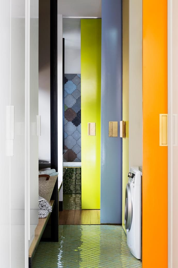Timber gives way to feature tiles and flashes of fruit-inspired colour on the sliding doors.
