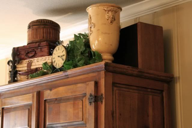 Great idea for decorating the empty space above an armoire for Ideas for things to put on top of kitchen cabinets