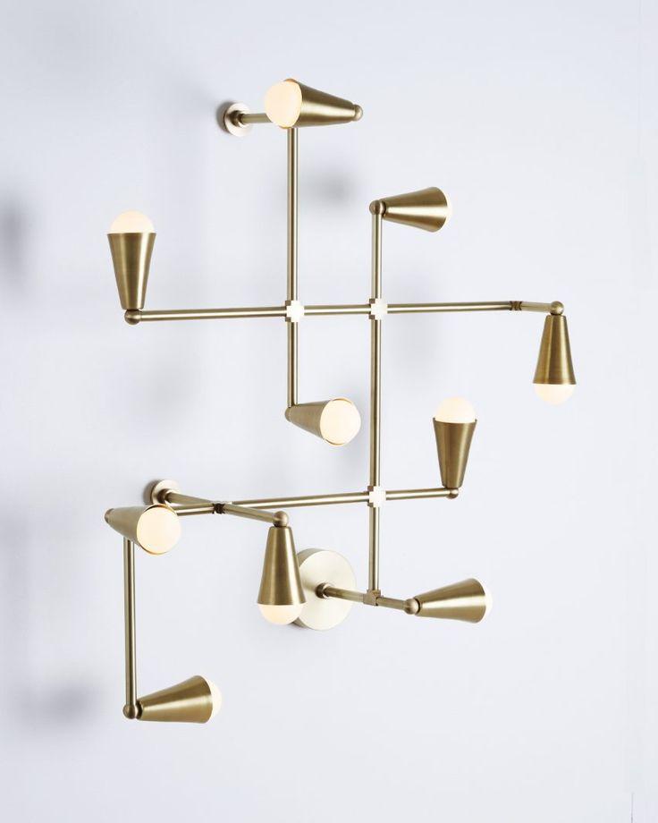 Superb Lightmaker Studio presents geometric brass lighting at IDS Toronto