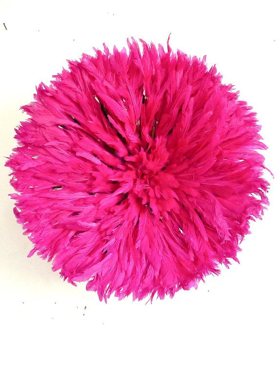 Juju Hat - Bamileke feather headdress - Fuchsia  Diameter : 50 cm  Traditional Headdress worn in Cameroon (Bamileke tribe) by the royal dancers during important ceremonies held by the tribal chief.  The feather headdress or juju hat symbolises prosperity and is believed to possess the