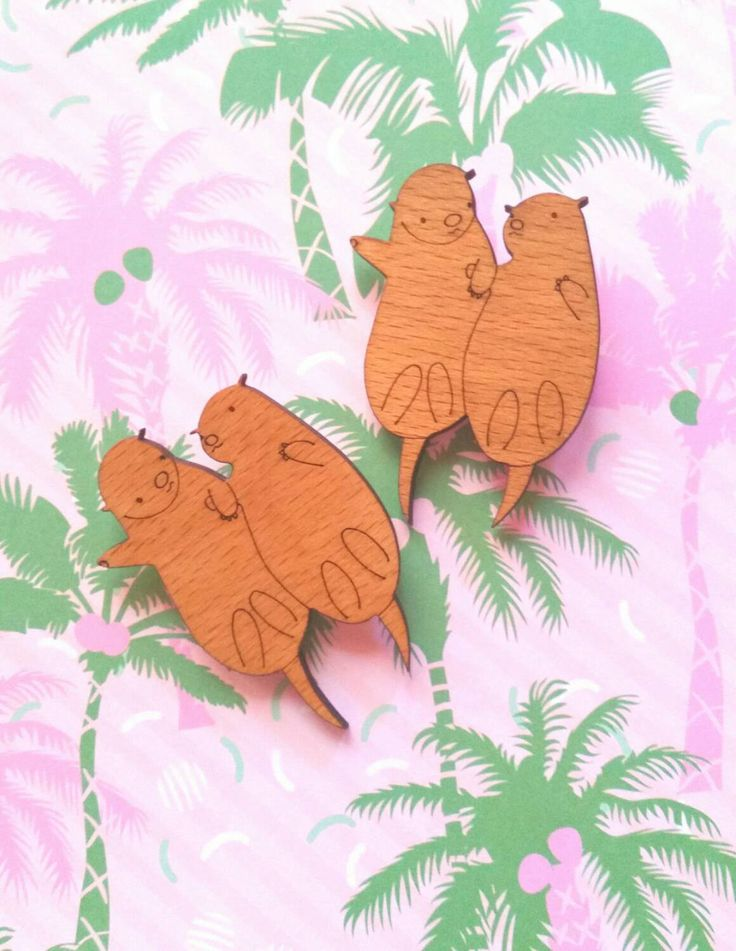Two Otters holding hands laser cut wooden brooch badge pin (7.00 AUD) by whimsicalduchess