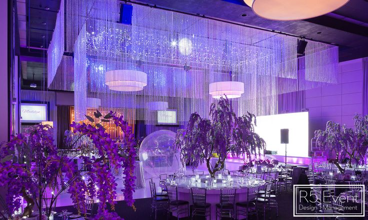 Full room shot of a glorious affair! Full event decor, chandelier, lighting, flowers ad tables by R5 Event Design