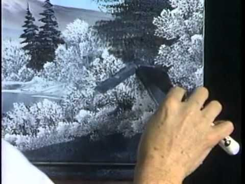 In a clip from this one-hour video workshop, Bob creates space for a cabin in the midst of snow-covered clearing.