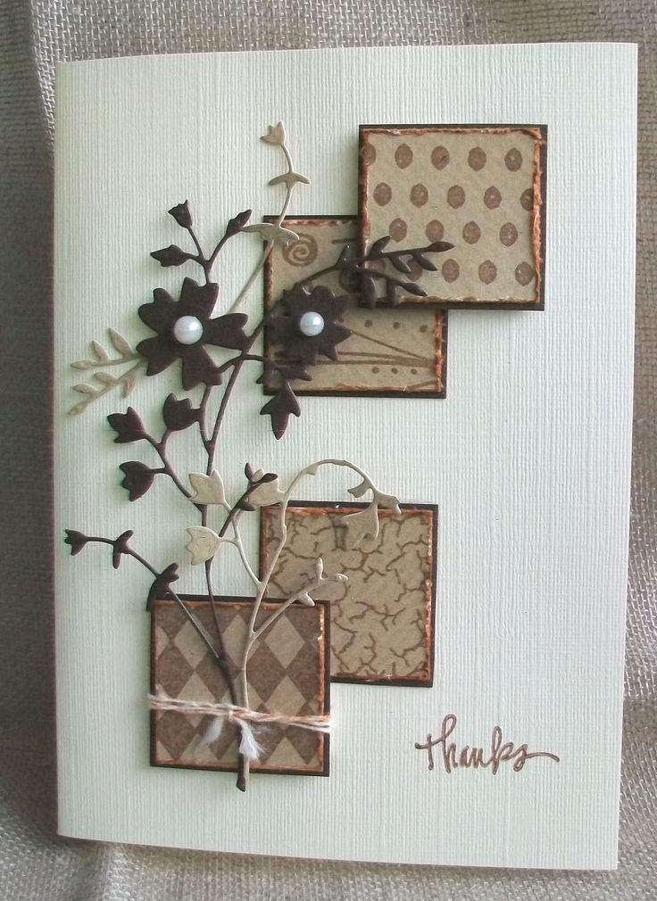 By Viv. Cut kraft paper into 4 squares, stamped each with a different background stamp, distress the edges & inked them with distress tea dye ink, then matted them onto brown cardstock squares. Die-cut flowers in brown and kraft. Cut the kraft one into parts & used only some of them. Glue pearls to the flower centers. Wrapped string around the bottom square & put the flower stem through it. Added sentiment.