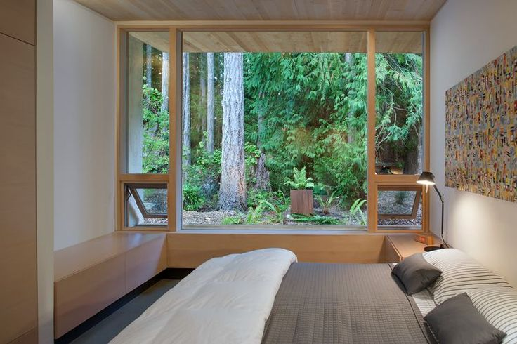 Custom bed and Tolomeo mini table lamp in bedroom of British Columbia cabin